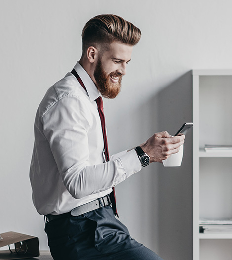 businessman-using-smartphone.-to check-seo-services-in australia-and-new-zealand